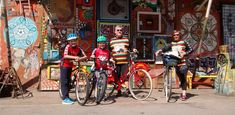 active family exploring Ljubljana on bicycles, guided tour, having fun.