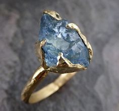 Raw Uncut Aquamarine Ring Solid 18k Gold Ring wedding engagement Rough Gemstone Ring Statement Ring Stacking 0199  I love natural raw gems! I hand carved the ring setting in wax then cast this treasure in recycled solid 18k gold in my home studio. I created a very organic rustic look to compliment the organic gemstone. This ring is about a size 6 3/4 it can sized.The stone is about 12mm X 8mm. Through out all of time and history in every tribe and culture all around the world crystals…
