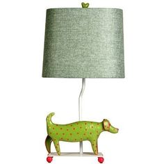 """Mini Dog Table Lamp Finish: Red by Style Craft. $69.95. L11085DS Finish: Red Features: -Materials: Iron Poly Resin.-White iron base.-Whimsical and charming little dog.-Footed base with matching finial.-Clear cord.-Oval racetrack fabric shade in textured fabric with rolled edge.-Wipe clean with soft cloth. Includes: -Rotary switch takes 60W bulb (included). Dimensions: -Shade dimensions: 9"""" H x 7"""" x 11"""" Bottom x 6"""" x 10"""" Top."""