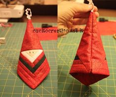 Tutorial Babbo Natale log cabin.  I.made a few before I figured to use 1 inch strips for the log cabin block. For the center square I used a 2 1/2 inch square. Works up fast and makes 2 at a time. Very cute