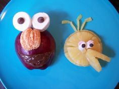 Elmo and Big Bird Fruit Snacks. We made these using 1 red apple, 1 clementine, Nutella, 1 large marshmallow, 1 mini marshmallow, 2 chocolate chips, 2 mini chocolate chips, 2 slices of canned pineapple.