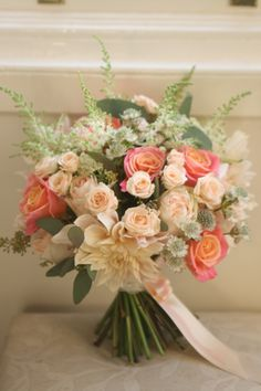 Wedding bouquet in coral and peach with miss piggy roses, café au lait dahlia, spray roses, astilbe, astrantia and eucalyptus. Liberty Blooms