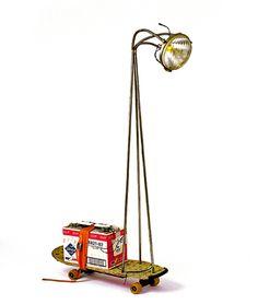 Libresse clip   jogging-lamp / amount: 1 / 1995   Skateboard  Headlamp Citroën DS  Libresse clip box  Battery  Lashing belt  Accessories: battery charger