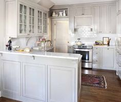 Pale gray kitchen cabinets with white marble counters