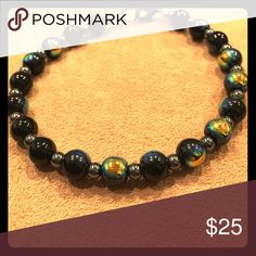 Unisex Positive Vibes Hematite Bracelet Black iridescent beads with Hematite beads to create positive vibes. Metal parts are zinc alloy which are nickel and lead free. **Hematite will help with absorbing negative energy and creates calm vibes in times of stress or restlessness. Hematite is a great protective stone and will assist in keeping oneself grounded when worn. Hematite is wonderful for the Root Chakra, it transforms negative vibes into creating energy into more positive vibration…