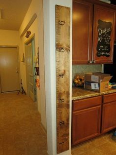 stained wooden growth chart