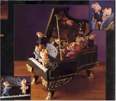 Piano - Music Mice-TroWith baton in hand, the mice-tro turns on the moving metronome and the mousical ensemble moves into action, gently moving in tempo to the music. The graceful ballerina and her partner perform their dance along the moving keys of the elaborately decorated grand piano. It's a symphony of exquisite detail and remarkable motion, as performers and conductor reach a crescendo of presentation worthy of Carnegie Hall!