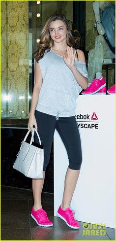 Miranda Kerr wearing Reebok SKYSCAPE RUNAROUND Shoes in Pink Fusion Reebok PWR Fitted Capri Reebok STUDIO CLOUD TANK Reebok Yoga Coverup