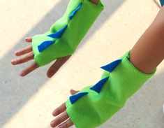 Our super DINOSAUR Fingerless Gloves are perfect for your dinosaur lover! Our dino gloves are the perfect cost effective gift, Halloween accessory,