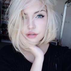 pale skin and white hair                                                                                                                                                                                 More