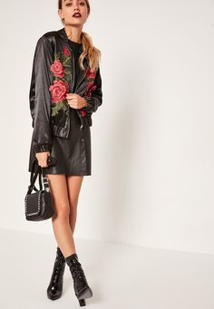 Go gothic with this black satin bomber jacket with luxe floral embroidered detailing.