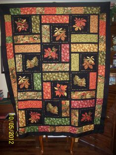 I am grinning from ear to ear over my fall quilt I just finished..