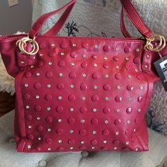 """Latique Vegan  Raspberry Studded Bling Handbag NWT Brand new with gold tone hardware and some beautiful bling.  Awesome color and a Big purse...measuring approximately 13"""" by 13"""" high.  Vegan materials.  Has some pockets inside along with a zipper pocket.  Also has a zipper in the back of the purse. Gorgeous color.  Two 21"""" straps. Very light weight flexible purse. Latique Bags Satchels"""