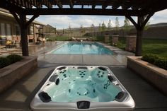 I love this idea. In-ground hot tub with a swimming pool. Relaxation and fun in one backyard.