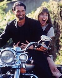 Xena and ares. On a motorcycle.