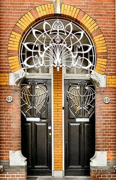 Beautiful Art Nouveau details in this duplex doorway. Cool Doors, Unique Doors, The Doors, Entrance Doors, Doorway, Windows And Doors, Art Nouveau Architecture, Architecture Details, Art Deco