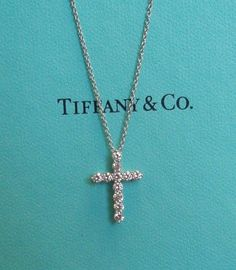 Glamour arrives with the sudden and breathtaking appearance of Tiffany diamonds. Necklace with a pear-shaped diamond drop in platinum. Diamond Cross Necklaces, Diamond Pendant Necklace, Tiffany & Co., Do It Yourself Jewelry, Tiffany Jewelry, Tiffany And Co Necklace, Cross Pendant, Pendant Set, Gold Pendant