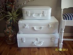 My vintage suitcase stack: Undercoat and spray of gloss white paint, and a vintage suitcase stack has new life