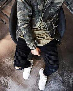 Adidas ultra boost, camo jacket, olive tee, distressed black biker denim jeans.