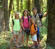 Kids hiking in  the woods of the Northwest