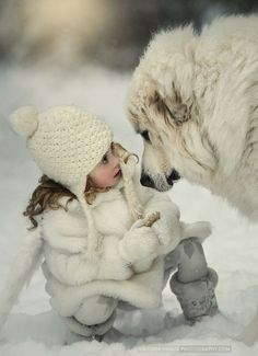 Great Pyrenees and his little snow girl