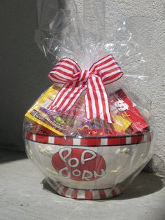 Quick and usable gift! Buy a bowl with a particular motif and fill with favorite candy or snack items.