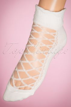 """These 30s Victoria Sockswill give your outfit a mysterious retro touch! The white socks are made from a high quality and comfy fabric finished off with stretchy band with puffy effect and """"lace up"""" detailing. Pair them with beautiful high heels and a skirt or dress for a lovely vintage look. Let your feet shine like never before with these must-haves! ;-)   White mesh on top Firm stretchy fabric"""