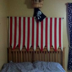 Make a pirate sail and mast to go above crib/bed. (Carter)