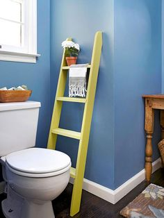 Paint a small ladder to fit in a narrow space next to the toilet to hold hand towels or magazines.