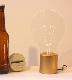 Exposed bulb Lamp with golden concrete base by SturlesiDesign, ₪215.00