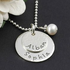 We love this pretty little hand stamped mothers necklace! Personalize however you wish! $59.00 http://www.wholesouljewelry.com/mothers-personalized-necklace-with-birthstone-or-pearl-natalie/