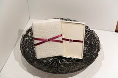 This elaborate #handmade boxed #wedding #invitation is wrapped in white silk with a white #lace overlay. It was inspired by the classic bride with decadent taste