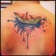 We love the mix of styles in this piece. Tattoo by Madame Chan #InkedMagazine #origami #tattoo #boat #tattoos #Inked #Ink #art