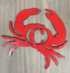 This is a brand new, handmade, laser cut crab with the initial of your choice. This item is sold UNFINISHED so it can be painted or stained any