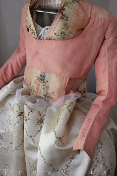 18th c… changeant pink silk Pierrot style caraco c. 1780 with a few scraps of brocaded silk taffeta and hand embroidered 18th c silk satin skirt