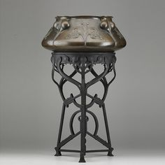"""English Arts & Crafts Large Jardiniere on Stand. Hammered and Embossed Copper Jardiniere & Patinated Iron Stand. Circa 1910. Jardiniere: 8"""" x 18"""", with Stand: 29-3/4""""."""