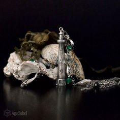 The Storm by Aga Sobel. Silver necklace with hand carved little lighthouse, tiny mermaid and seaweed. Art Clay Silver, sterling silver and gemstones.