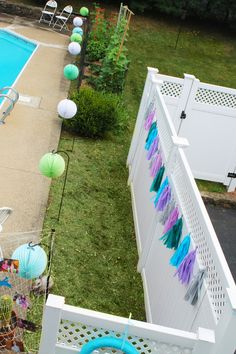 Project Nursery - Mermaid Under the Sea Birthday Party - The yard was decorated with lanterns and tissue paper garland from Etsy - Pom Love