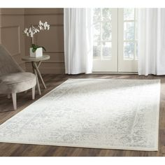 Features:  -Material: 100% Polypropylene.  -Reynolds collection.  Technique: -Machine woven.  Material: -Synthetic.  Material Details: -100% Polypropylene.  Primary Color: -Ivory/Silver.  Rug Shape: -