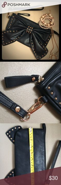 Charming Charlie Studded Bow Wristlet Rose gold colored hardware. In excellent used condition! Wrist strap and zipper in excellent condition. Interior lining has a few small marks from use. I received so many compliments on this bag! Bag measures 9 x 5 inches. No trades. Charming Charlie Bags Clutches & Wristlets