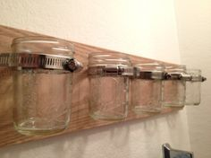 wood + hose clamps + mason jars = storage catch-all