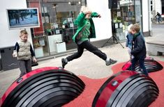 """""""This playground in Odense is an interactive dreamspace. It is linked to similar places in Esbjerg and Vejle, and you create patterns of light and sound together with children and adults in the other cities. Medea's Mads Hobye is one of the developers."""" Playspot Odense - Image Credit: Kim Rune"""