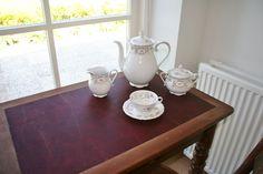Met uitzicht op de tuin een kopje thee drinken.
