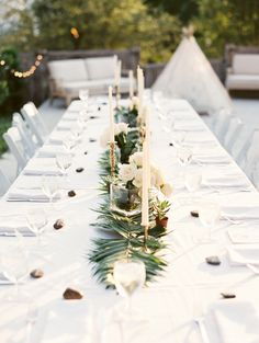 Gorgeous tablescape with tapered candles and a #teepee. Photo: Kristen Kilpatrick