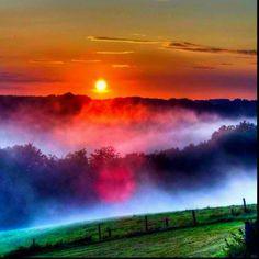 Zonsopgang a la regenboog