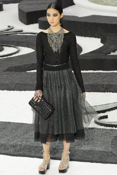 CHANEL... I don;t like the shoes... and would prefer classic pumps and pearls with this timeless ensemble