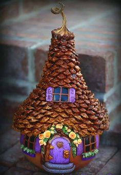 Step by step DIY fairy house - large pinecones to use for shingles, dry-brushing on some sienna and metallic gold acrylic paint, polymer clay etc. great fun to make look at more similar DIY creativity marking like this on online DIY fairy house Fairy Garden Houses, Fairy Gardens, Fairies Garden, Gnome Garden, Diy Fairy House, Fairy House Cake, Fairy Crafts, Fairy Doors, Clay Crafts