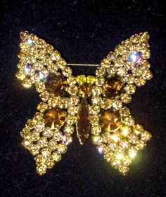 Rhinestone butterfly brooch on Sale just in time for the holidays at BANGLES & BEADS Antique and Vintage Jewelry.