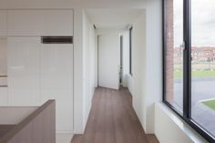 :: DETAILS :: INTERIORS :: adore the work of iXtra Interieur Architectuur | Living spaces. Photo Credit: www.ixtra.be Lovely detailing of flush doors, no door jambs, reveal details where cabinetry meets drywall. Subtle colour palette with dark framed windows, subtle yet timeless #details #interiors