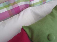 Piling on the pillows - fun coloured checks with classic tailored white with block coloured cushions in wool. Made in Portugal / Empilhando as almofadas - quadrados de cores divertidas com branco clássico com cores sólidas em burel. Feito em Portugal